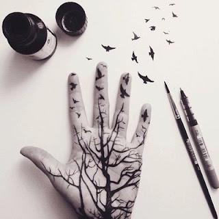 menulis di tangan