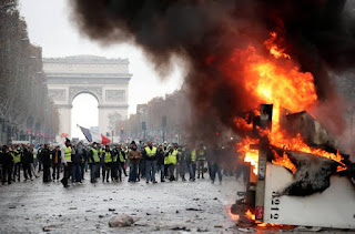 Police fire tear gas and water cannons to disperse protesters in Paris.