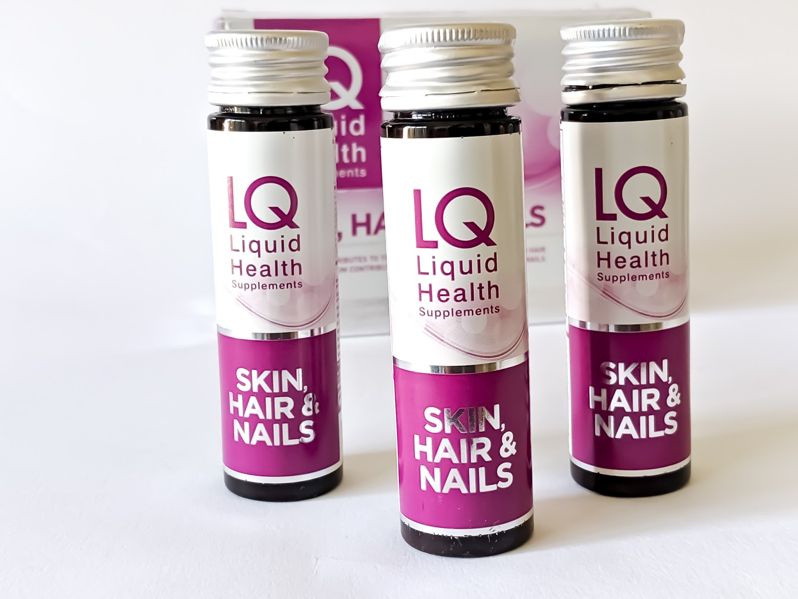 Image of three bottles of LQ Liquid Health Hair, Skin and Nails