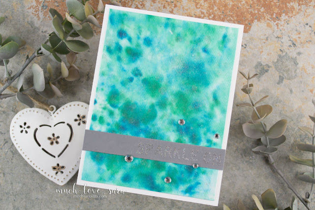 This Sparkling Card featured a fun watercolor splatter background, created with Fun Stampers Journey Silks.  The sentiment stamped with the brand new Letterboard Sentiments stamp set, is heat embossed with a custom sparkle embossing powder blend.  #fsjallday