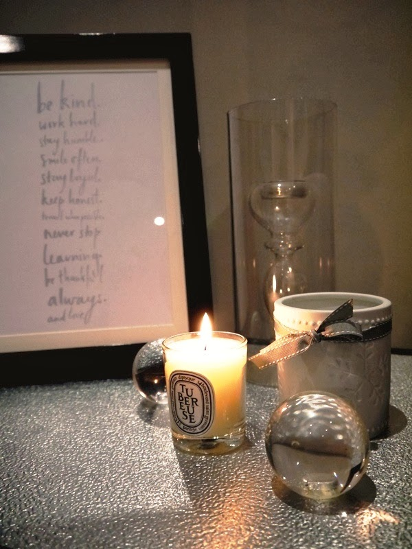 Diptyque candle, crystal balls, framed quotes