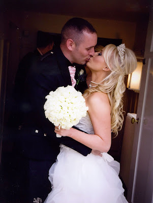Blonde bride kissing her groom. Long blonde soft waves with height at the crown and tiara