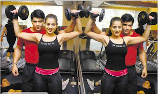 Amisha Patel Doing Dumbbells