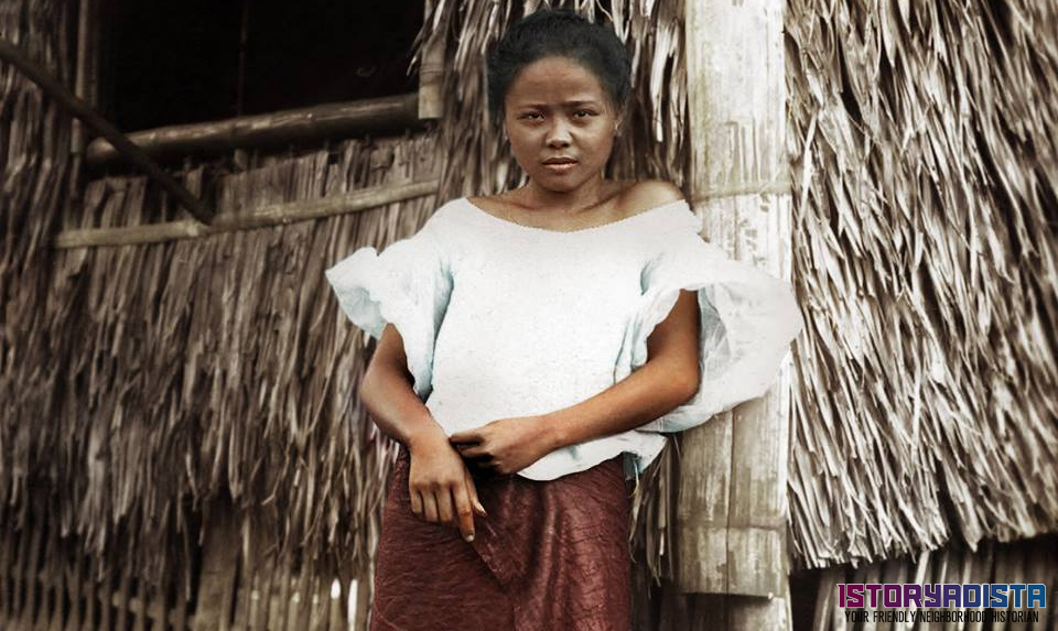 Filipino girl posing at a nipa hut (c1910)