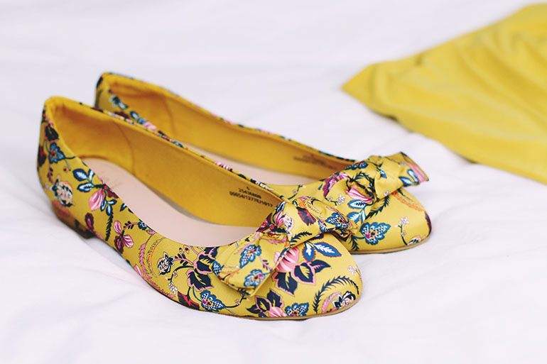 Yellow embroidered flat shoes