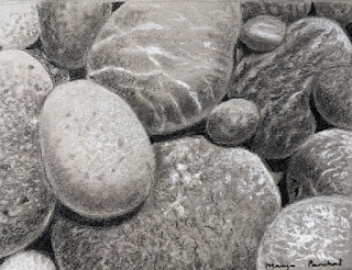 Charcoal drawing of rocks and pebbles at the beach on Strathmore gray toned paper by Indian artist Manju Panchal