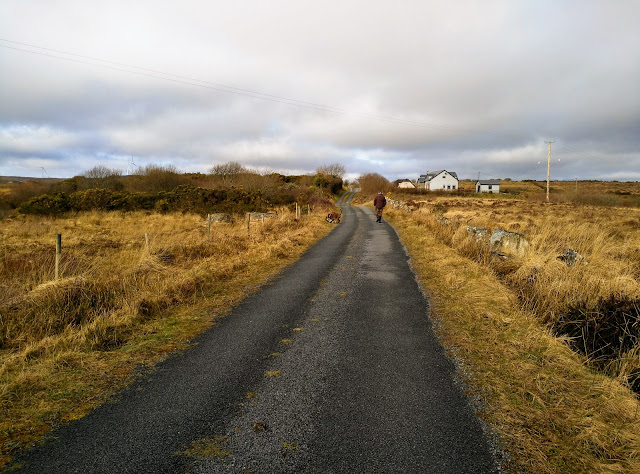 road in Connemara Ireland, house in distance