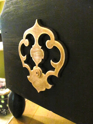 decorative metal piece from vintage drawer pull