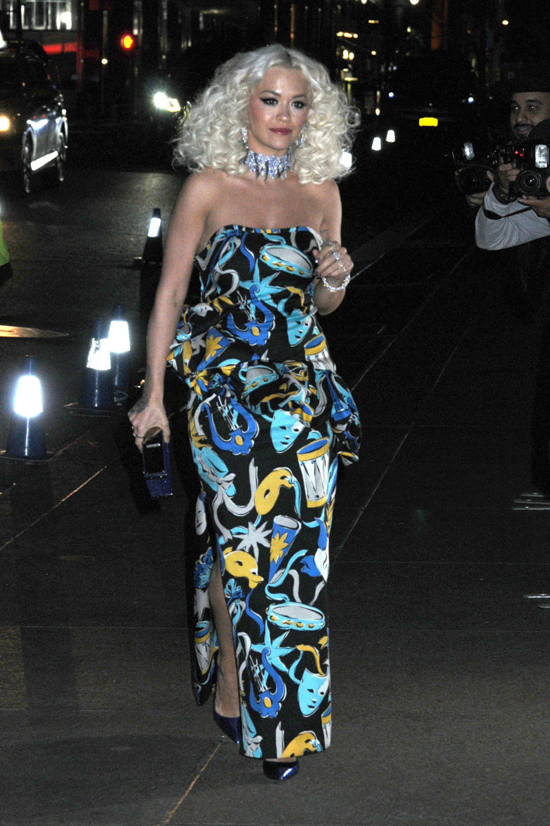 Rita Ora rocked curly blonde hair and a strapless dramatic dress at Marc and Char's wedding