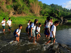 Almost four years ago we saw the hardship of the students in Rodriguez Rizal just to get to their school. Some of the students have to use bamboo rafts just to get to the other side of the rive where their school is situated, while some have to wade through the waters.