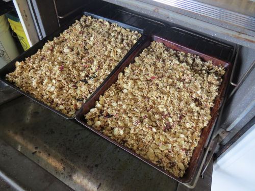 granola on baking sheets