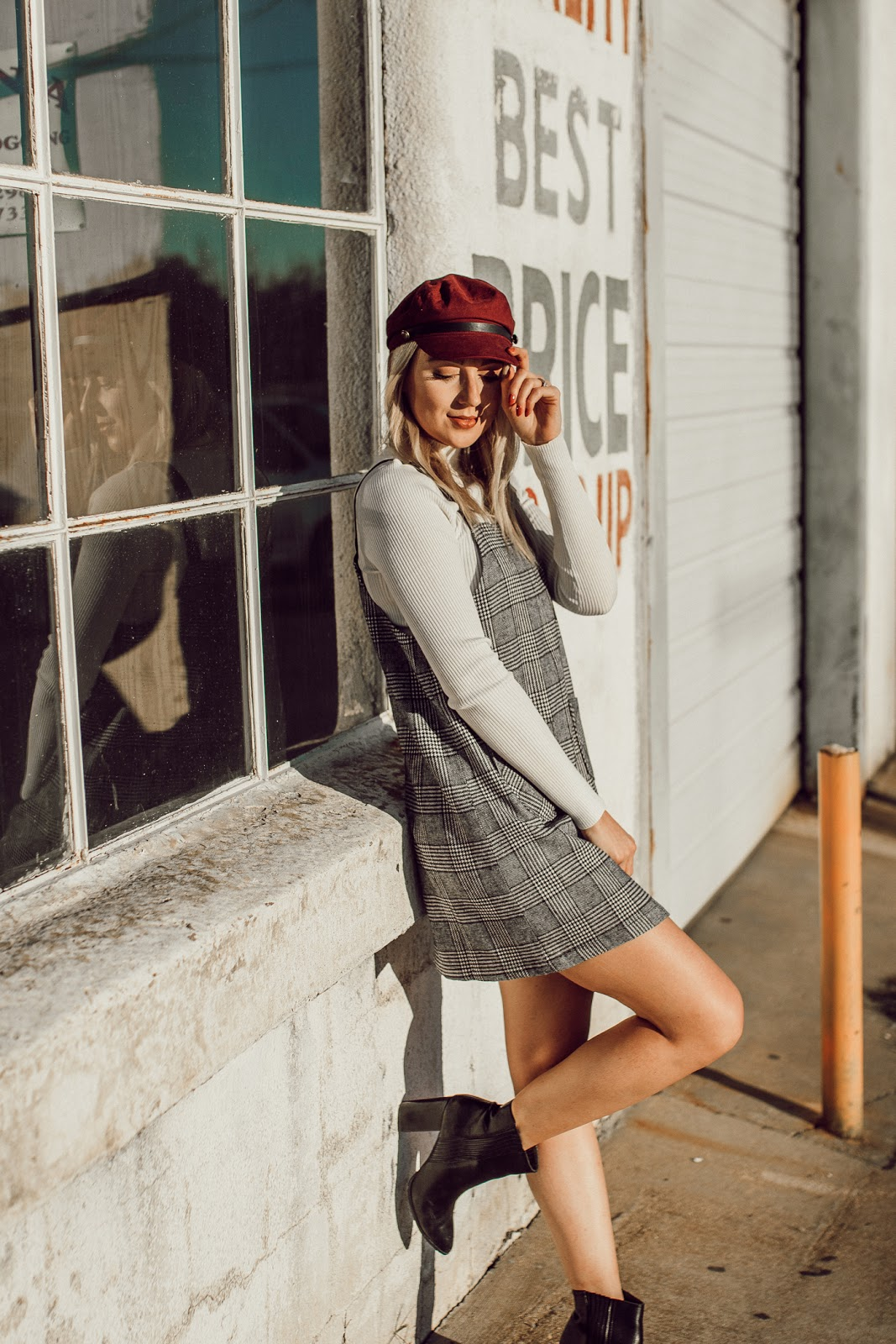 Plaid jumper dress with a mock-neck top and cabby hat