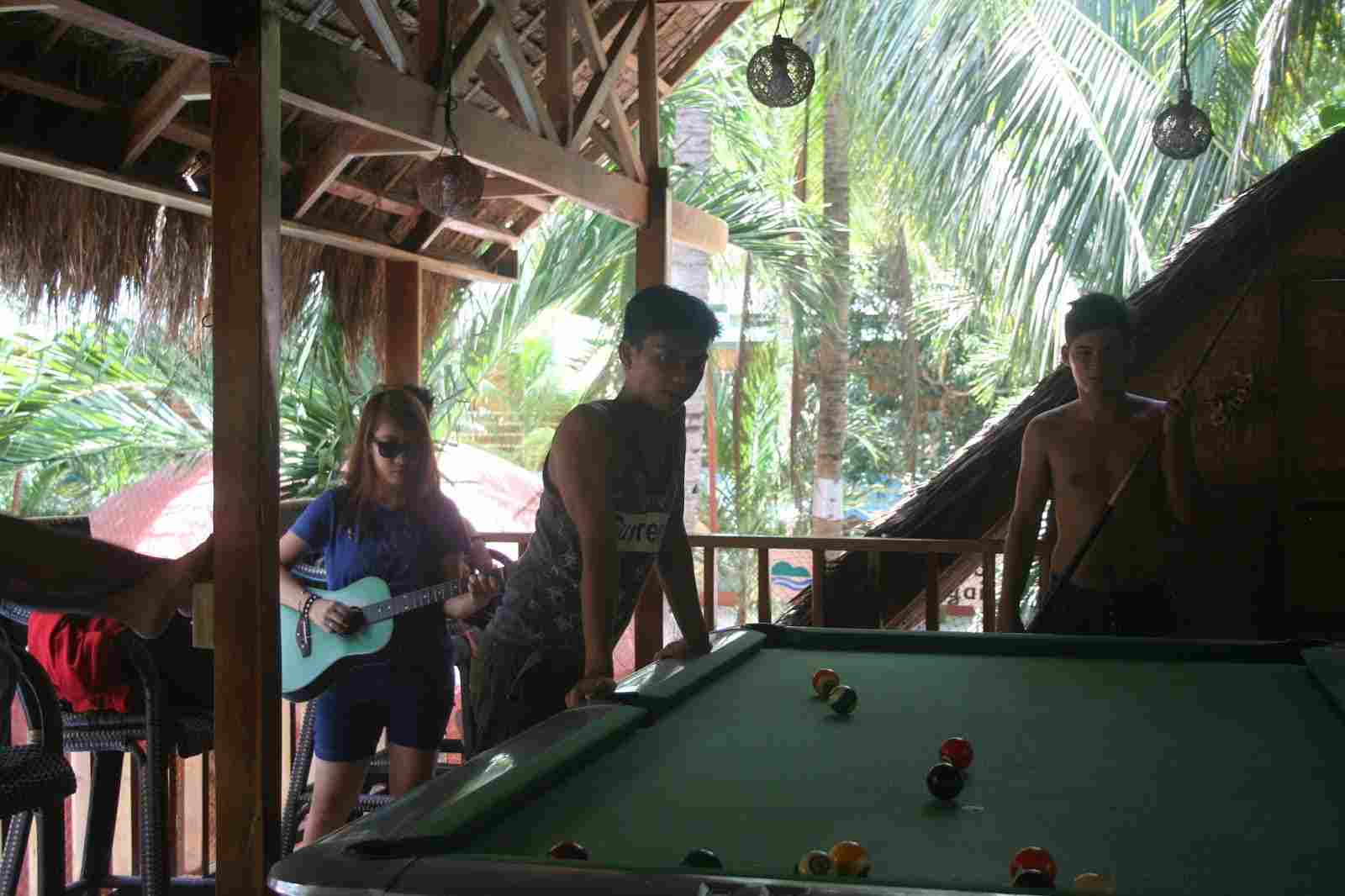 budget cheap resort in panglao white island bohol philippines in 2018, best travel summer vacation tour, panglao chocolate hills resort billiard area, billiard playing with friends