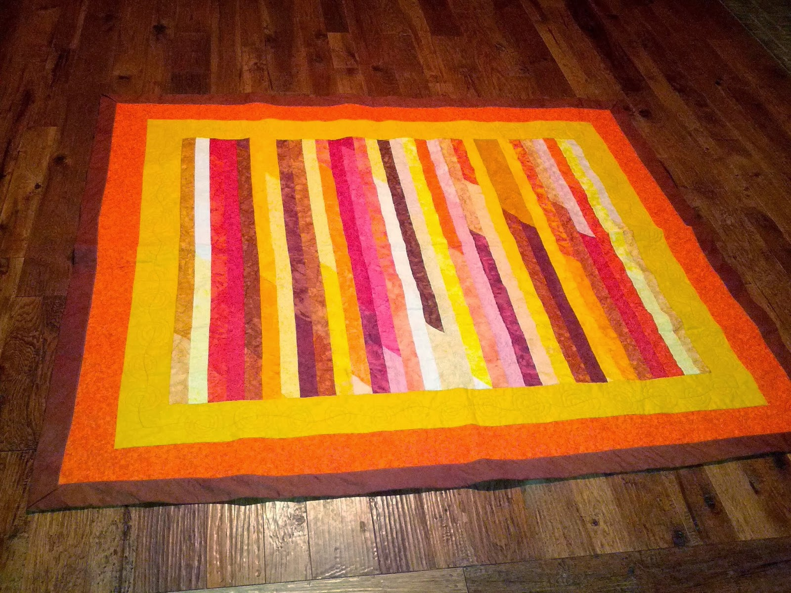 http://www.quiltparadigm.blogspot.com/2014/01/my-favorite-to-date-qayg.html