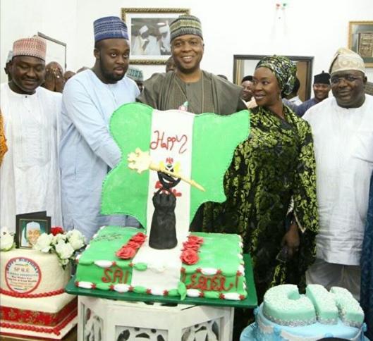 Photo of Senate President, Bukola Saraki cuts 54th birthday cake with his wife & son