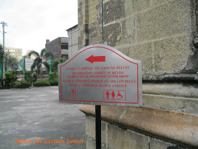 Signpost pointing to bell garden of Manila Cathedral.