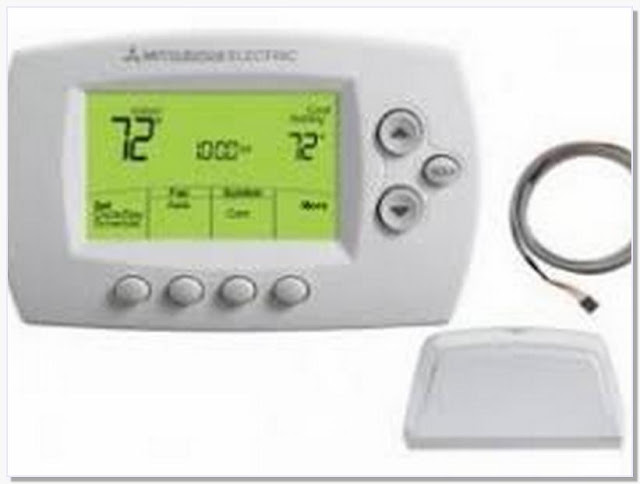 Thermostat with wireless remote sensor