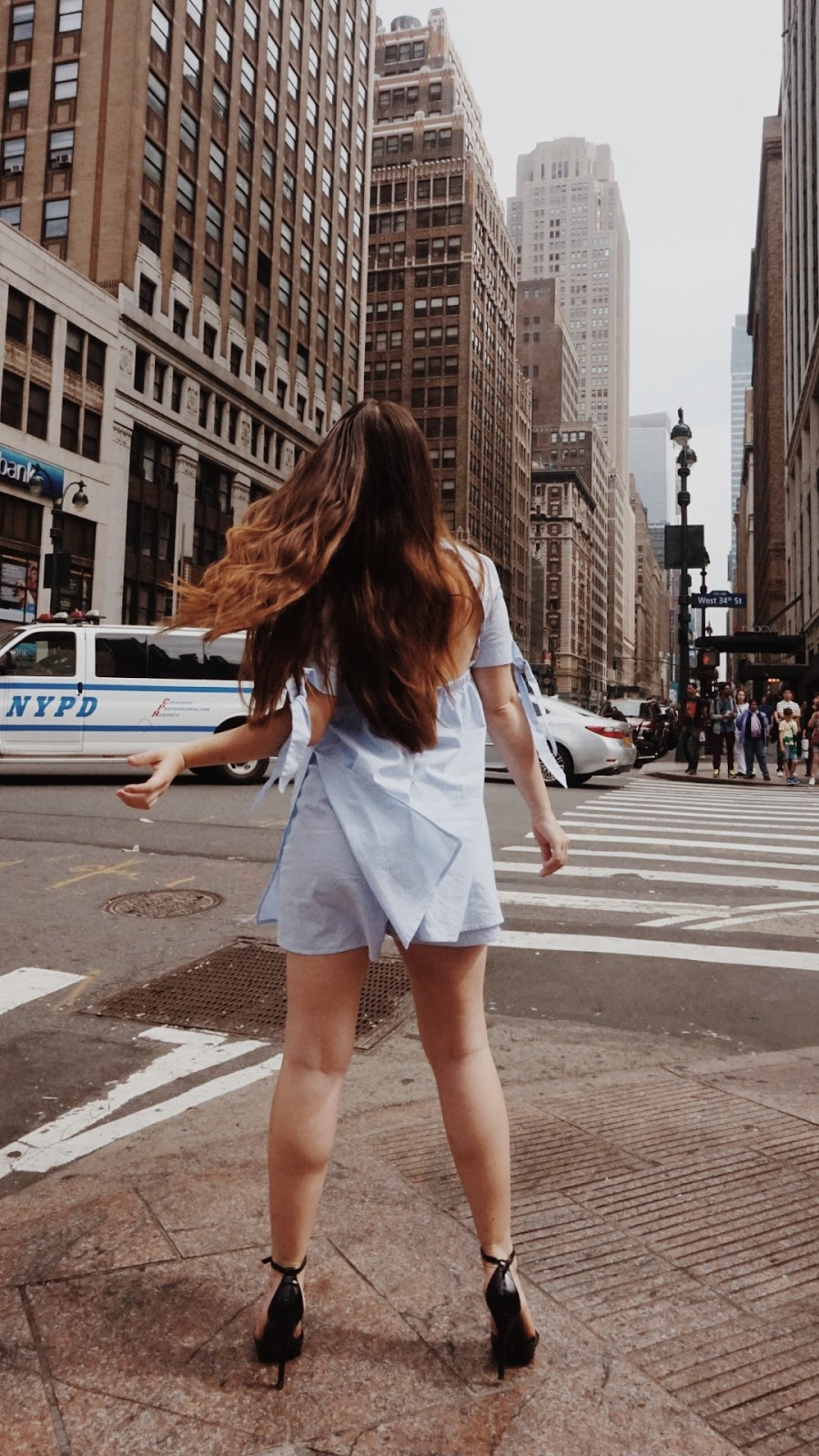 girl standing on NYC street corner of New York