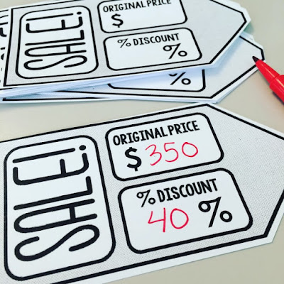 Students find the discounted prices of objects in our classroom with these sale tags.