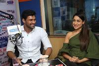 Pragya Jaiswal in a single Sleeves Off Shoulder Green Top Black Leggings promoting JJN Movie at Radio City 10.08.2017 026.JPG