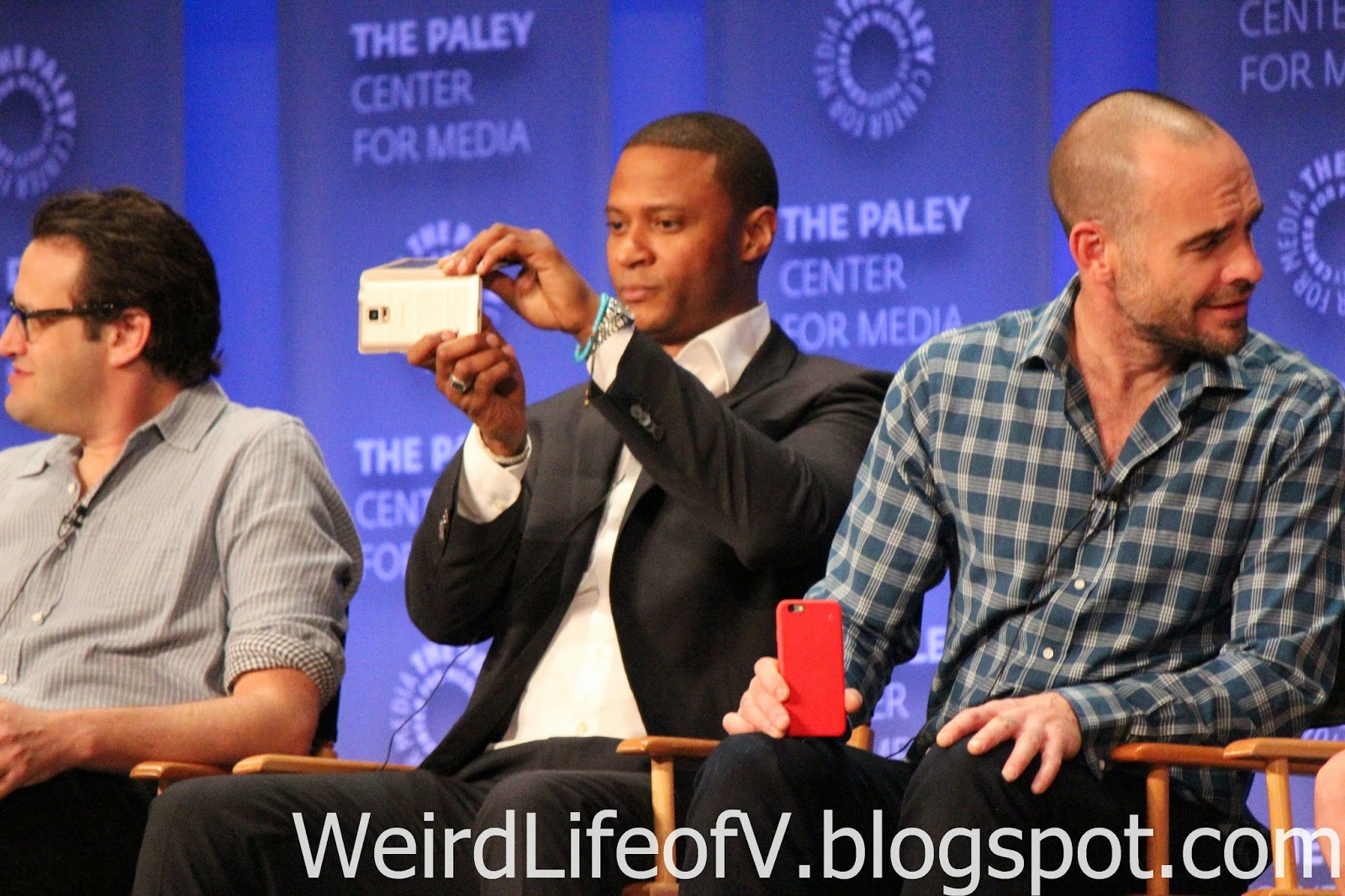 David Ramsey taking a photo of the audience
