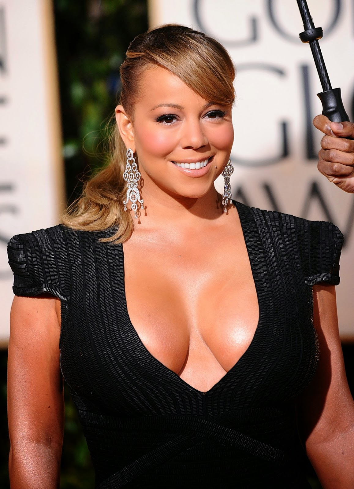 Mariah Carey's 14th album will be released Beyonce style