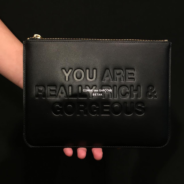Leather zip pouch by Comme de Garcons and Bureau Betak