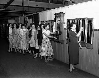 Burton workers clocking out of work - 1960s