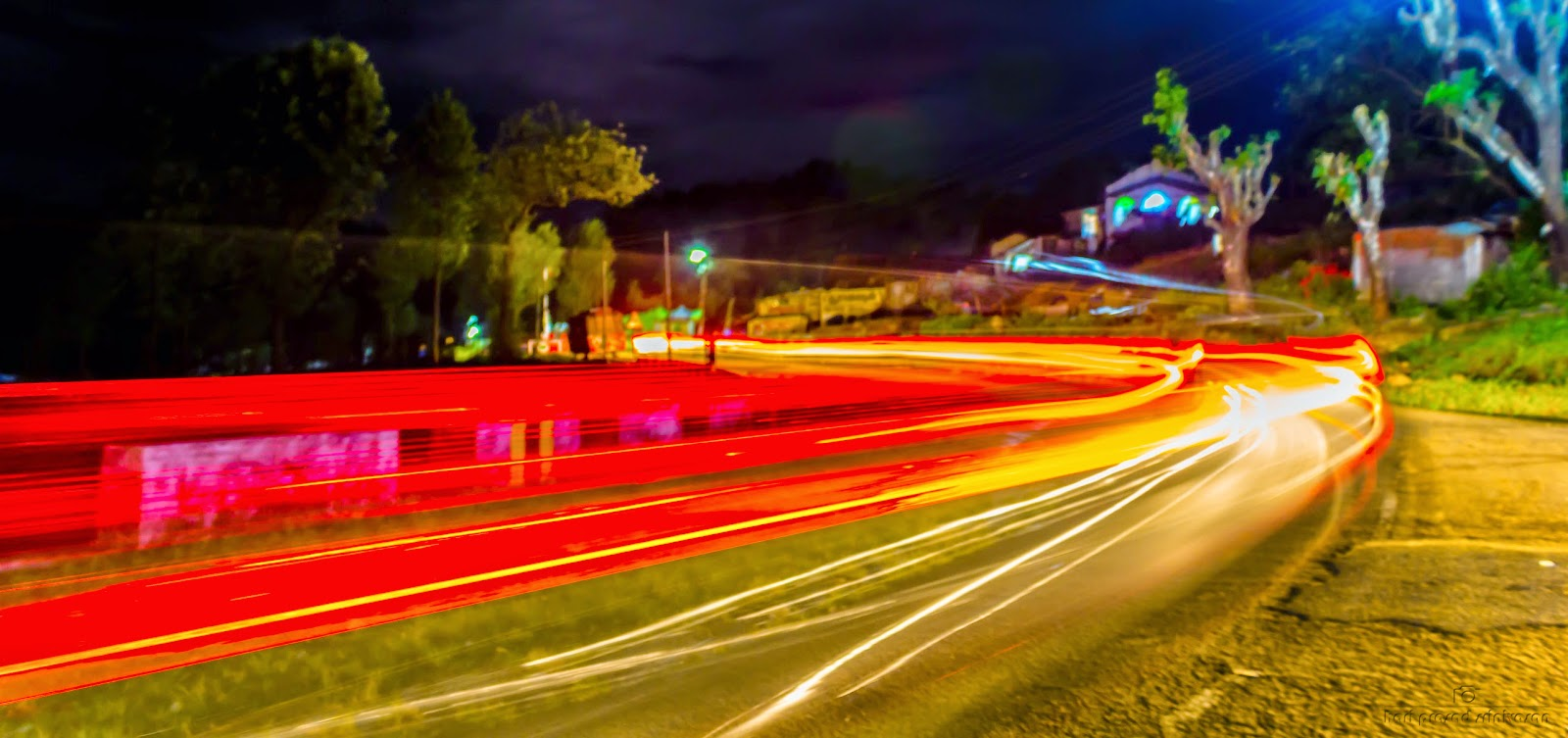 Long exposure - passing lights by vehicles
