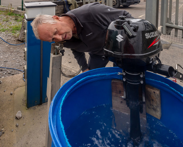 Photo of Phil testing our outboard motor