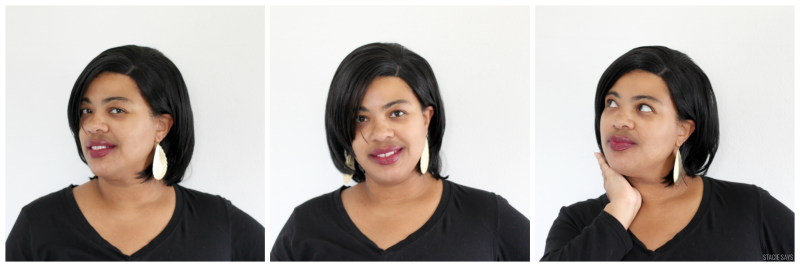 a black woman wearing a black bob wig