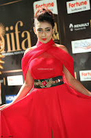 Apoorva in a Stunning Tight Leg Split Sleeveless Red Gown at IIFA Utsavam Awards 49.JPG