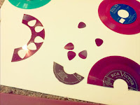 Guitar pick cut outs from records