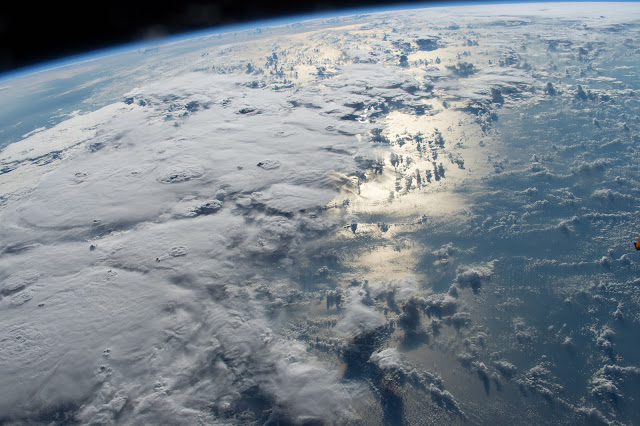 Clouds and Sun's reflection on Pacific Ocean seen from the International Space Station