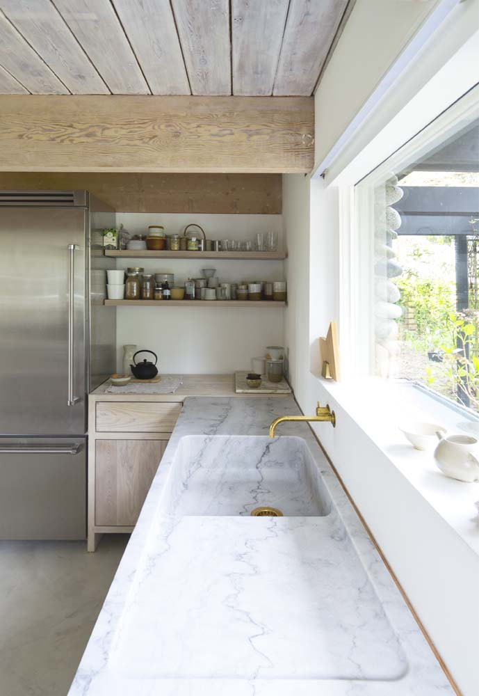 A Pristine Kitchen with Open Shelves and Lovely Marble Countertop