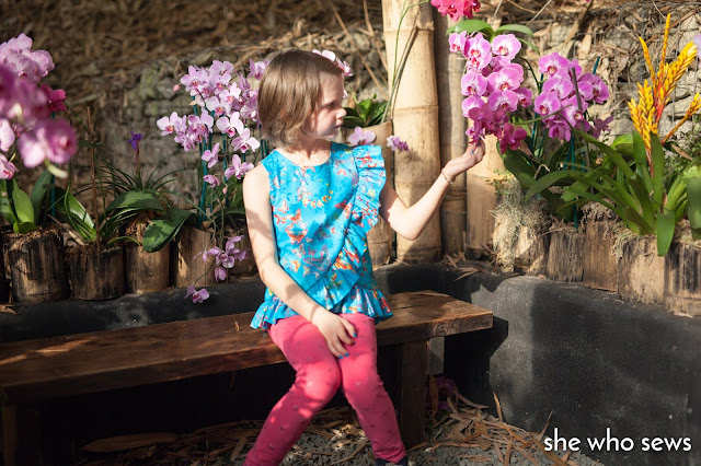 blue butterfly blouse in orchid house