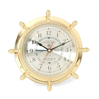 http://bellclocks.com/xcart/ship-s-wheel-tide-time-clock-lacquered-brass-case-with-beveled-glass-bey-berk.html?category_id=37