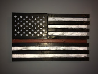 What flag is black with a horizontal blue stripe