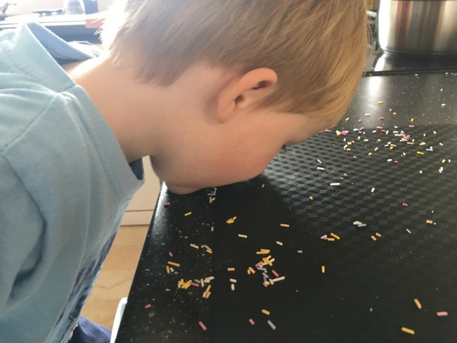 #MySundayPhoto-Number-42-toddler-eating-sprinkles-from-kitchen-worktop