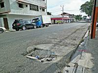 Resultado de imagen para calles con hoyos en barahona