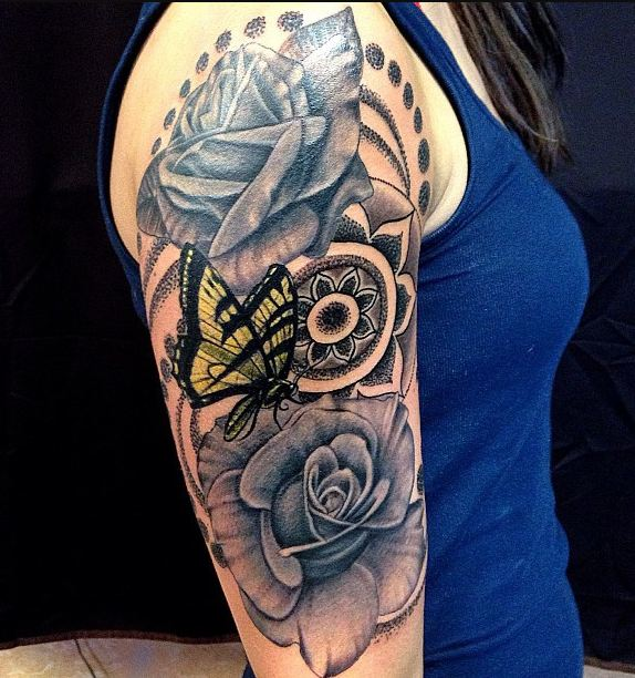 5ac69bcf02f72 2. For girls, the best sleeve tattoo design would be flower sleeves. It  would look even more beautiful with butterflies.