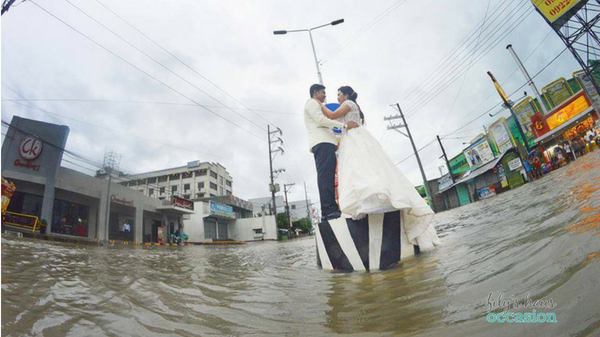 Wedding photoshoot continues amidst flood