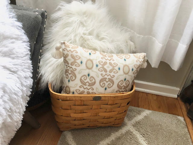 Peterboro Basket used to store throw pillows