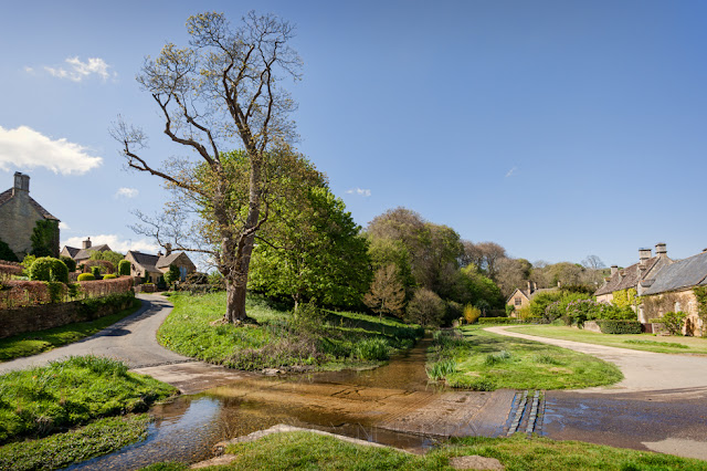 Idyllic Cotswold village of Upper Slaughter in the spring sinshine