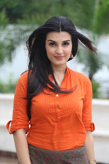 Shiny Doshi Looks So Hot In Orange Top