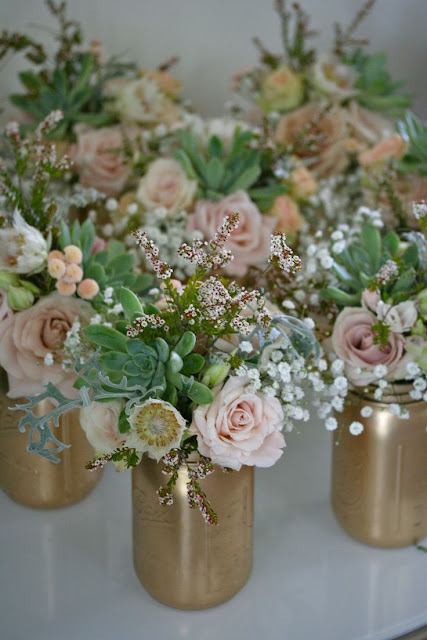 gold painted Mason jars with succulents