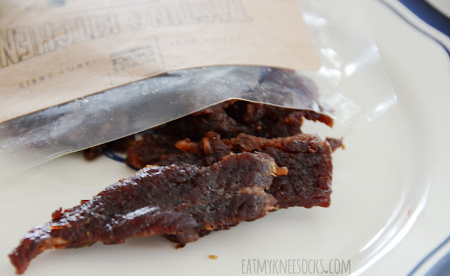 The Tasting Kitchen line from People's Choice Beef Jerky includes bold, eccentric flavors such as orange honey teriyaki, sriracha, sweet chili habanero, and garlic ginger beef snacks.