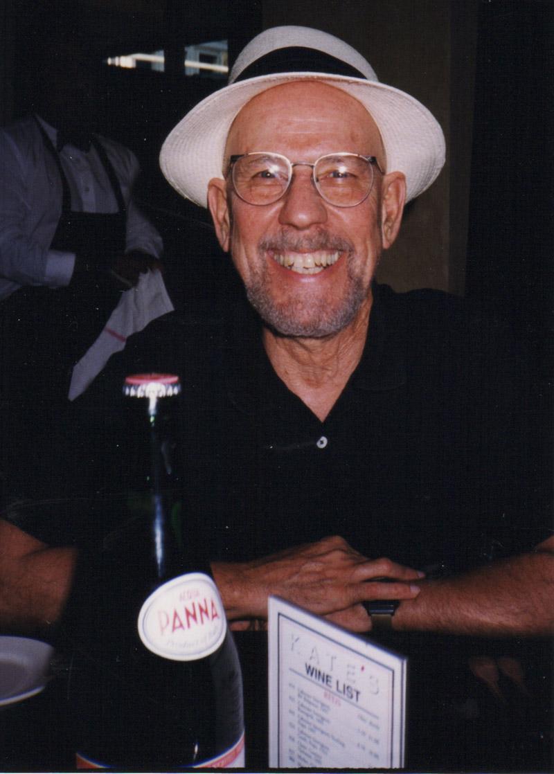 Albert Marsh at dinner in white hat 1990s