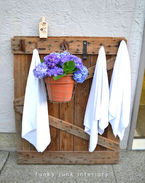 Hang the pool towels on this handy old barn gate by adding hooks!