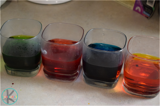 four-glasses-with-water-with-food-coloring
